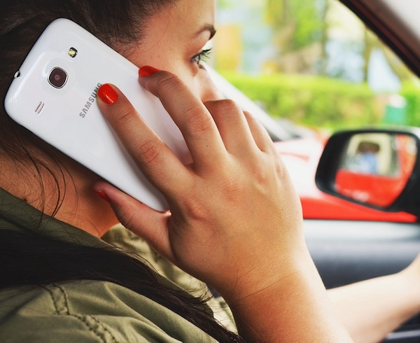 Stiffer laws in force for drivers caught using mobiles